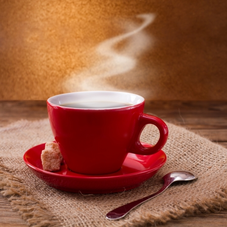 Coffee cup and saucer on wooden table  Free space for your text  photo