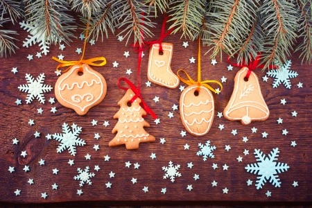 Gingerbread cookies on wooden background. Christmas card. Free space for your text photo