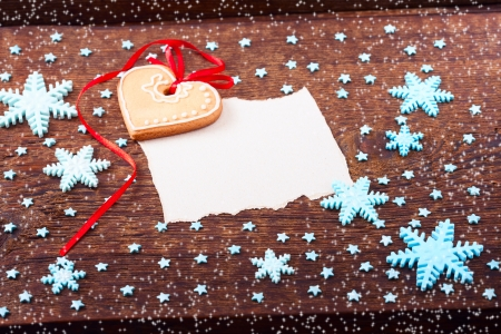Gingerbread cookies on wooden for Christmas card.  photo