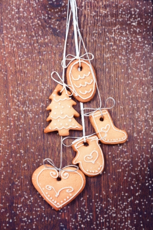 Gingerbread cookies on wooden  Christmas card. photo