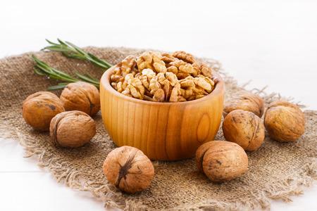 filbert: Hazelnuts, filbert on old wooden background closeup