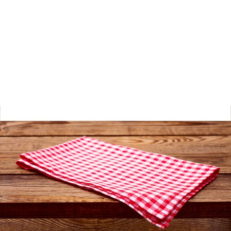 on the tablecloth: Empty wooden deck table with tablecloth for product montage. Free space for your text Stock Photo