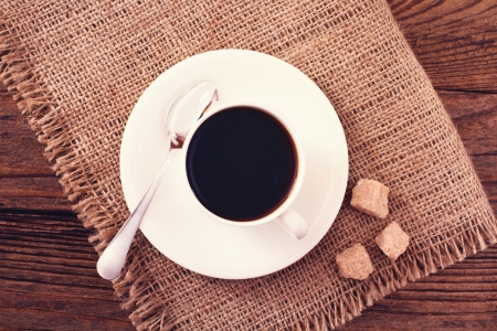 Coffee cup and saucer on wooden table. Free space for your text Stock Photo - 24546830