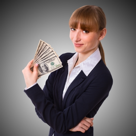 Happy business woman holding cash dollars in the hands of welcoming smile  The concept of finance success  Isolated, space for text photo