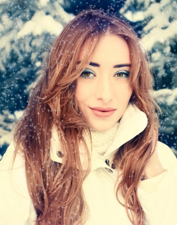 winter portrait of  beautiful blonde  Fashion makeup and clothes photo