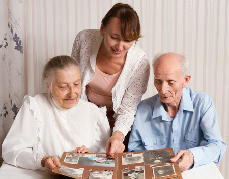 Senior Man, Woman with their Caregiver at Home  Concept of Health Care for Elderly Old People, Disabled photo