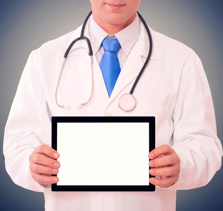Doctor working with tablet. isolated photo