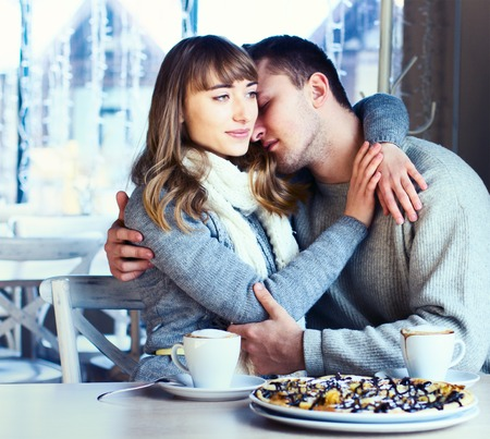 relationship love: Portrait of Beautiful Young Couple in Love, couple having fun talking in cafe and drink coffee. Concept of relationship, love story, preparations for wedding. Stock Photo
