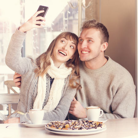 relationship love: Portrait of Beautiful Young Couple in Love in cafe  Concept of relationship, love story, preparations for wedding  Stock Photo