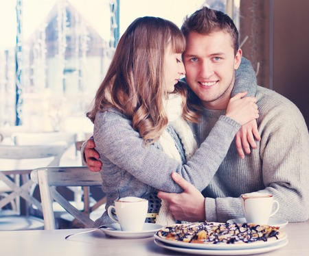 Portrait of Beautiful Young Couple in Love in cafe  Concept of relationship, love story, preparations for wedding  photo