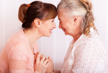 Seniors woman with her caregiver at home Stock Photo
