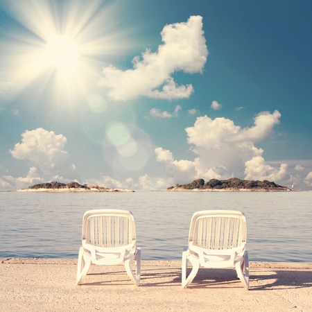 Beach two chairs on sand beach. Concept for rest, relaxation, holidays, spa, resort. Stock Photo