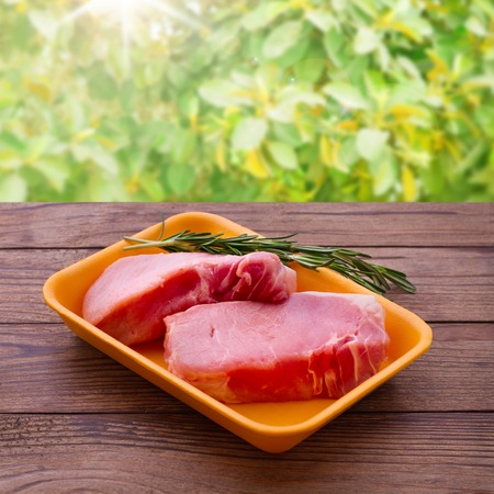 Raw meat for barbecue with fresh vegetables wooden surface. Food, meat raw steak, beef steak bbq, spices for cooking meat photo