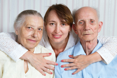 home health care: Senior man, woman with their caregiver at home. Concept of health care for elderly old people, disabled Stock Photo