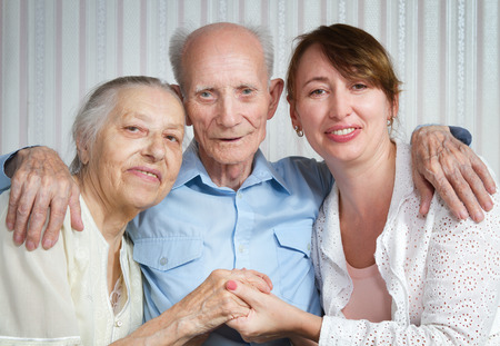 Senior man, woman with their caregiver at home. Concept of health care for elderly old people, disabled 写真素材