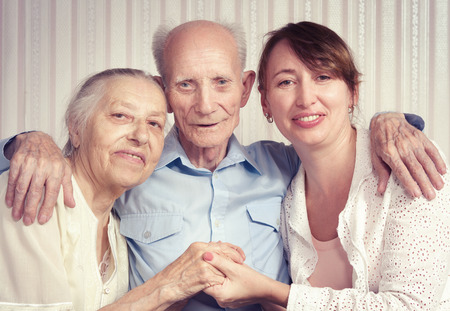 Senior man, woman with their caregiver at home. Concept of health care for elderly old people, disabled Stock Photo - 27597407