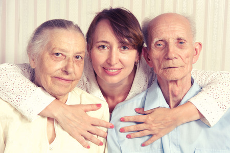 Senior man, woman with their caregiver at home. Concept of health care for elderly old people, disabled Stock Photo - 27597425