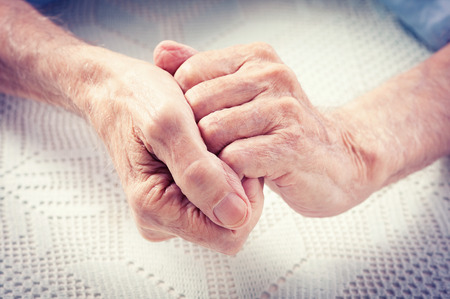 Care is at home of elderly  Old people holding hands closeup  Elderly man  Stock Photo