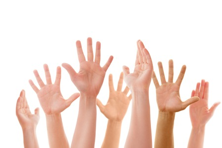 Raised up hands of many people isolated photo