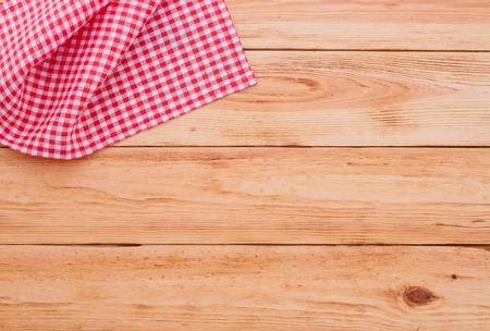 picnic cloth: Pure notebook for recording menu, recipe on red checkered tablecloth tartan. Wooden table close up view from top