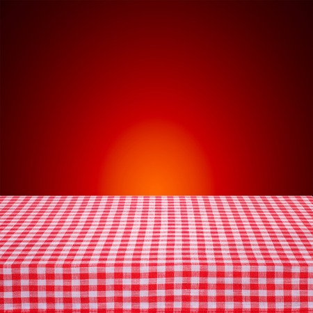 Canvas texture or background on the table. Red checked tablecloth view from top. Empty tablecloth for product montage. photo