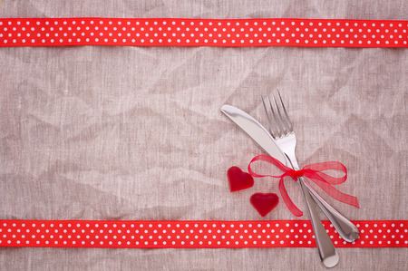 Cutlery on tablecloth view from top. Product pages for installation recipe books menu, event, valentine photo