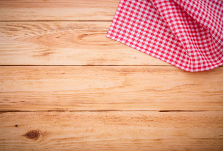 red and white: Pure notebook for recording menu, recipe on red checkered tablecloth tartan. Wooden table close up view from top