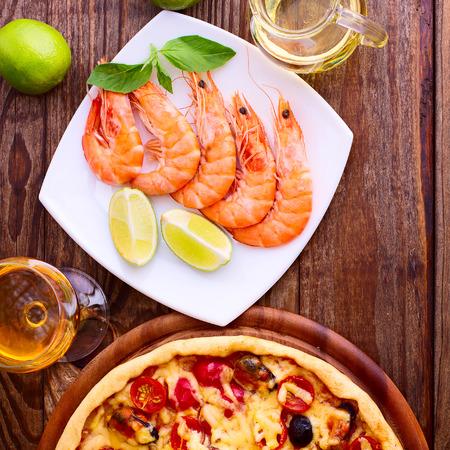 Pizza with seafood. Seafood Italian Pizza slice on wood dish originality. Italian kitchen studio. photo
