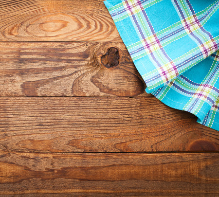 cook book: Pure notebook for recording menu, recipe on checkered tablecloth tartan. Wooden table close up view from top Stock Photo