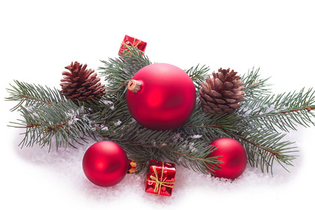 Christmas ornaments on Christmas tree. Christmas border with ornament, present and snow photo