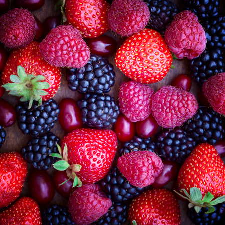 strawberries, dogwood, blackberries and raspberries top view, close-up