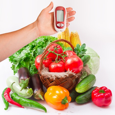 Vegetables isolated on white macro. Woman testing for high blood sugar.