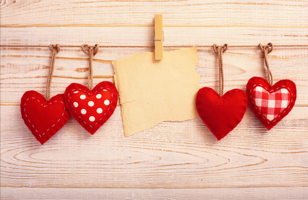 Valentines Vintage Handmade Hearts over Wooden Background. Valentine over Wood. Retro Styled Wallpaper. Valentines Day. Paper Tag labeling. photo
