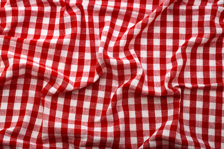 Wrinkled tablecloth red tartan in cage texture wallpaper. Unique perspectives top view. photo