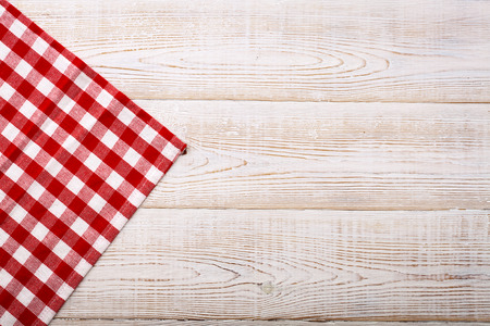 picnic cloth: Top view of checkered tablecloth on white wooden table. Unique perspectives
