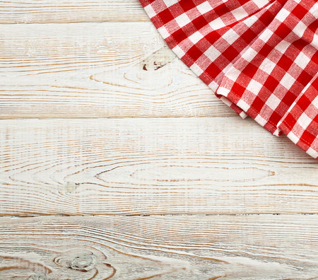 Top view of checkered tablecloth on white wooden table. Unique perspectives photo