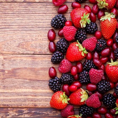 Mix of fresh berries closeup on rustic wooden background Reklamní fotografie
