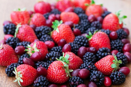 Berries, summer fruit on wooden table. Healthy lifestyle concept,