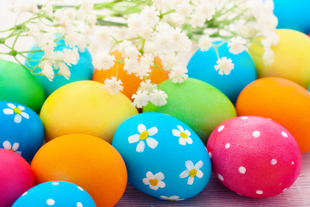 Easter eggs on wooden background. Holiday background. photo