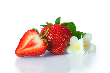 Ripe fresh strawberries were placed on white background Banco de Imagens