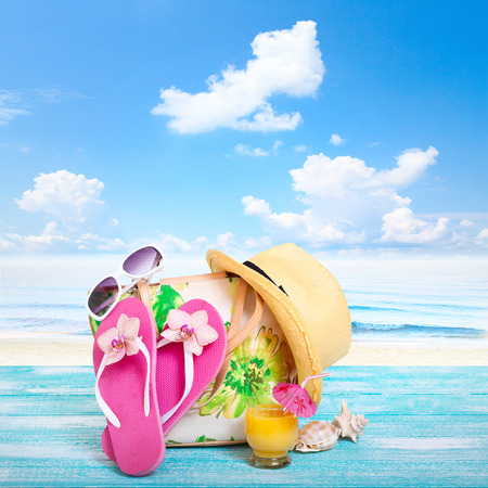 flip flops on the beach: Summer Holidays in Beach Seashore. Beachwear on wooden background. Vacation at sea