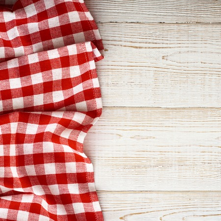 picnic cloth: Tablecloth tartan on white wooden table. Flat mock up for design. Top view.