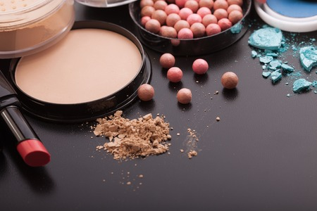 Various makeup products on dark background with copyspace 写真素材
