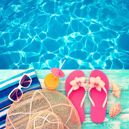 Summer vacation. Pink sandals by swimming pool. Blue sea surface with waves, texture water. Flat mock up for design.