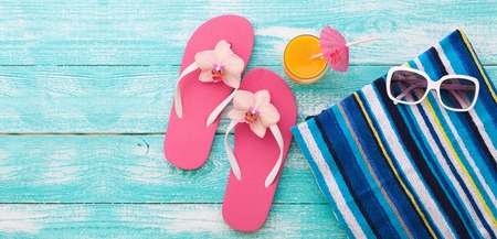 suntanning: Summer vacation. Pink sandals by swimming pool. Blue sea surface with waves, texture water. Flat mock up for design.