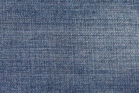 in jeans: pantalones vaqueros de la vieja textura de la lona cerca de macro
