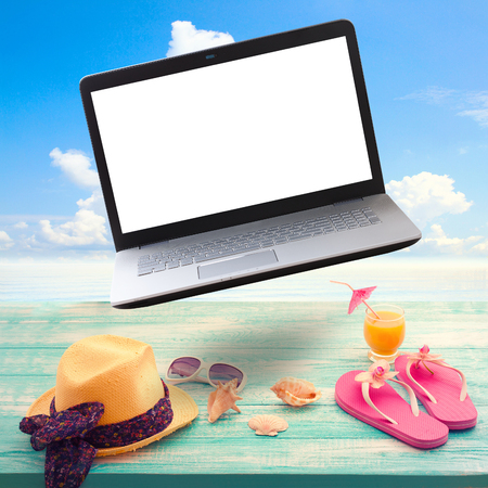 necessities: Summer background with summer necessities and laptop with white screen. Stock Photo