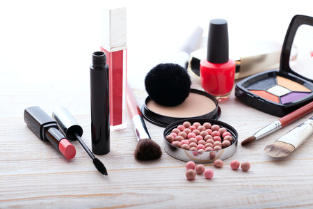 eyemakeup: Makeup cosmetics products on white wooden background with copy space. Cosmetics make up artist objects: lipstick, eye shadows, eyeliner, concealer, nail polish, powder, tools for make-up Stock Photo