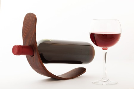 unusually: Glass and bottle of red wine. Flat mock up for design unusually on white background. Stock Photo