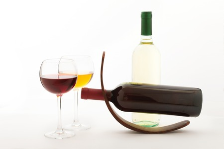 unusually: Glasses and bottles of wine. Unusually on white background.